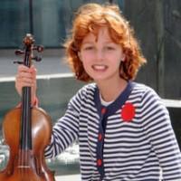 Francesca Rijks and her full fare violin.