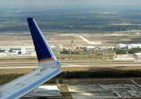 An overview of Houston Intercontinental, with the B concourse visible behind the winglet.  Photo: Chuck Slusarczyk Jr. - OPShots.net