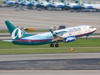 An AirTran 737 departs Atlanta with a number of company 717's visible at the gates.  Photo:  Mark Plumley - OPShots.net
