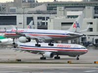 An pair of American Airlines aircraft are viewed at Miami in this 2008 file photo.  Photo:  Mark Plumley - OPShots.net