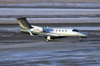 A Flight Options Phenom 300 taxies at Hopkins airport in January.  Photo: Chuck Slusarczyk Jr. - OPShots.net