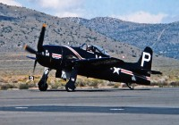 Howard Pardue taxies in his beautiful aircraft at the Reno Air Races in September 1985. He would take fifth place in the Unlimited Silver Class race with an average course speed of 359.415 mph. This aircraft was one of two original prototypes built out of an eventual run of 1,266 airframes, and still flies to this day. (OPShots Slide Collection - Photographer Unknown)
