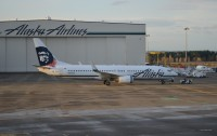An Alaska Airlines 737 getting towed to its gate on a Seattle morning.  Photo:  Cole Goldberg - OPShots Contributor