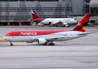 An Avianca 767 taxies out while a TACA A320 is serviced at Miami in 2010.  Photo: Chuck Slusarczyk Jr. - OPShots.net