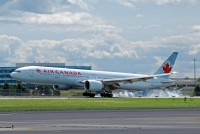 An Air Canada 777-300 touches down in Toronto in this photo from 2010.  The actual plane that performed the search was a -200 model. // Photo:  Doug McElroy - OPShots Contributor
