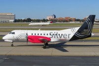 A Silver Airways Saab 340 taxies in Atlanta in October 2012.  Photo:  Andrew Thon - OPShots Contributor